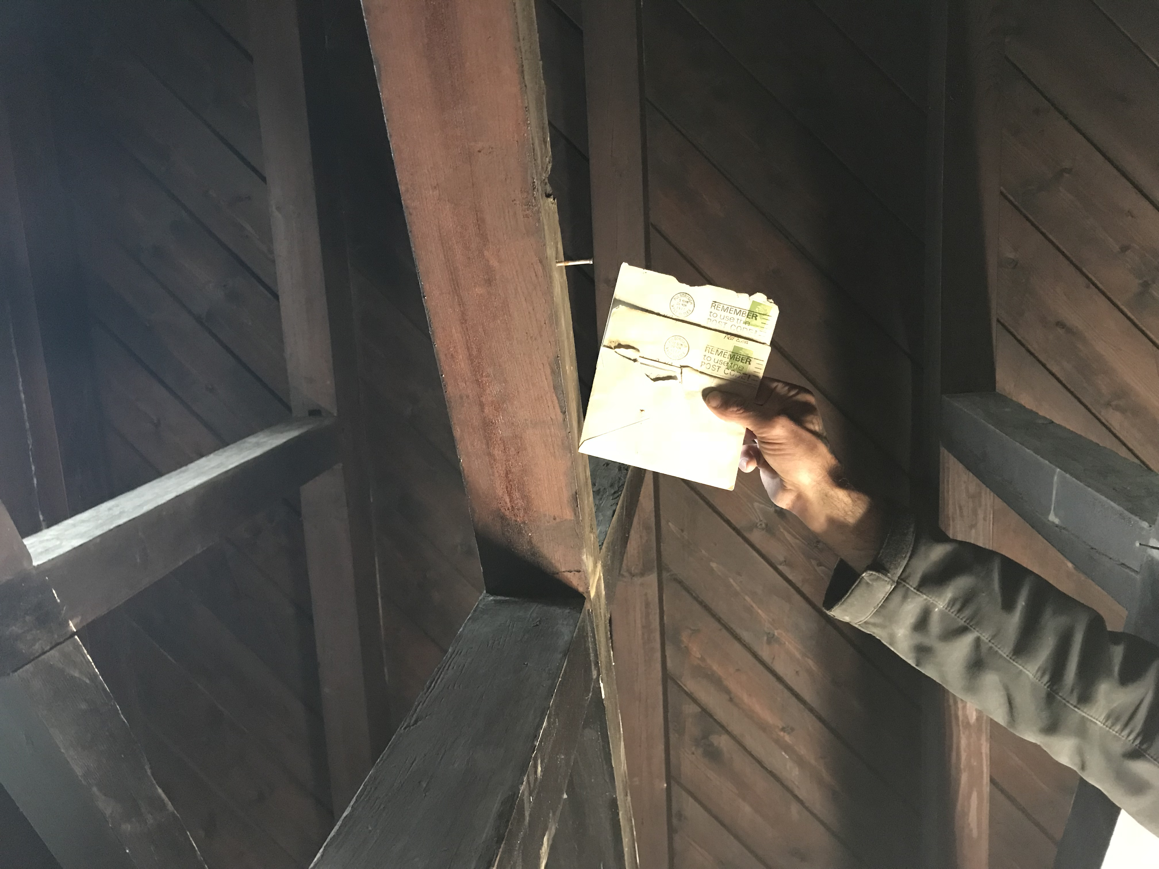 Letters found pinned to a beam in the roof.