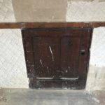 Low level door to the back of a Sacristy Cupboard