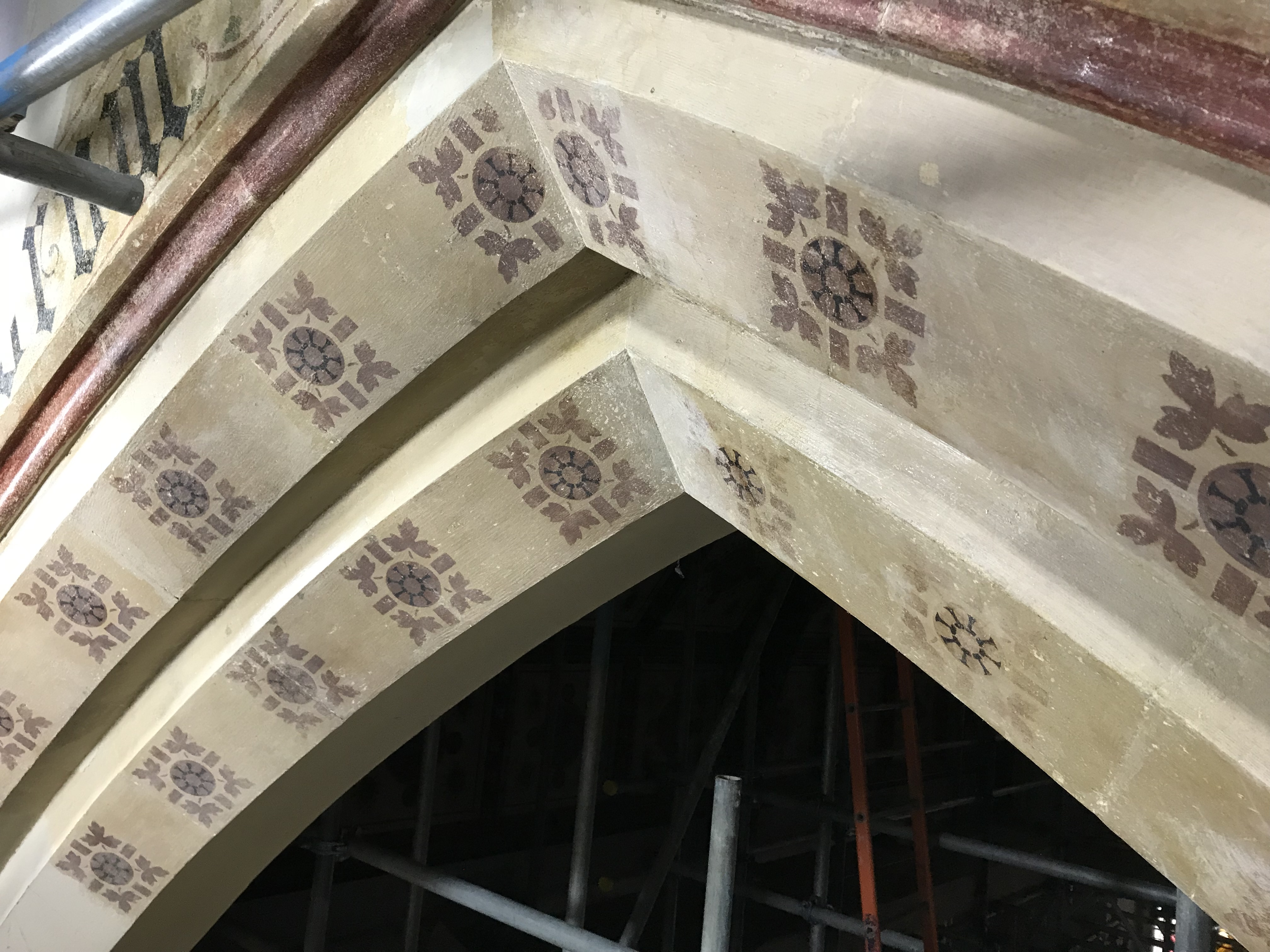 Miguel restoring the historic stencilling on the chancel arch.