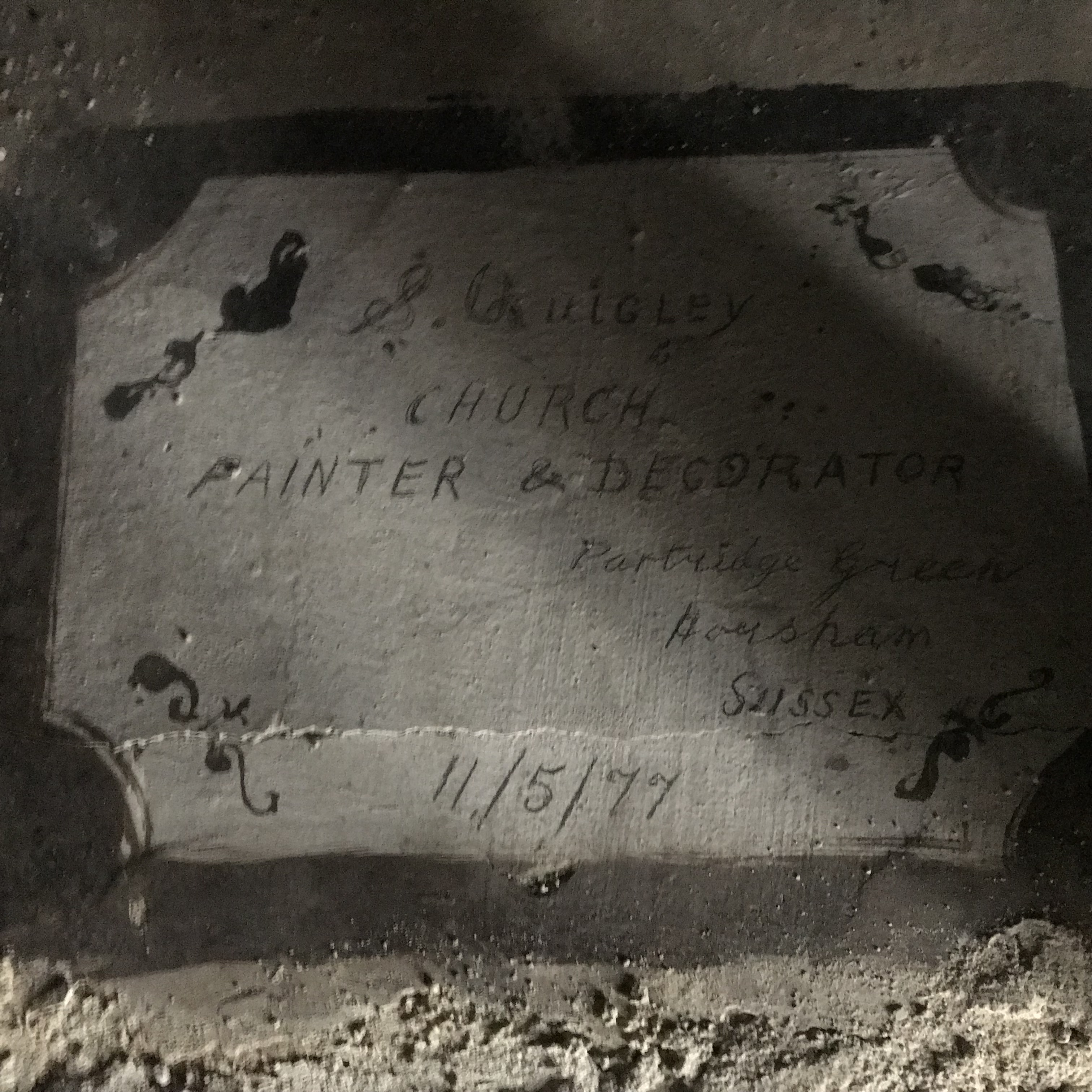 An inscription left by the last decorators who painted the church dated 11th May 77.